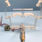 Mechanical clamping allows drones to hang from objects